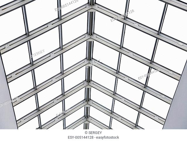 Glass roof with metal frames in an interior