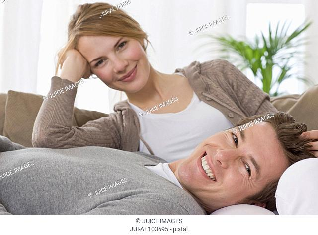 A young couple on the sofa together