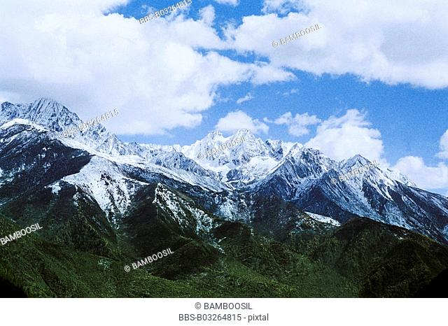 View of snow-covered mountains against cloudy sky, Mugecuo , Kangding County, Ganzi State, Sichuan Province of People's Republic of China