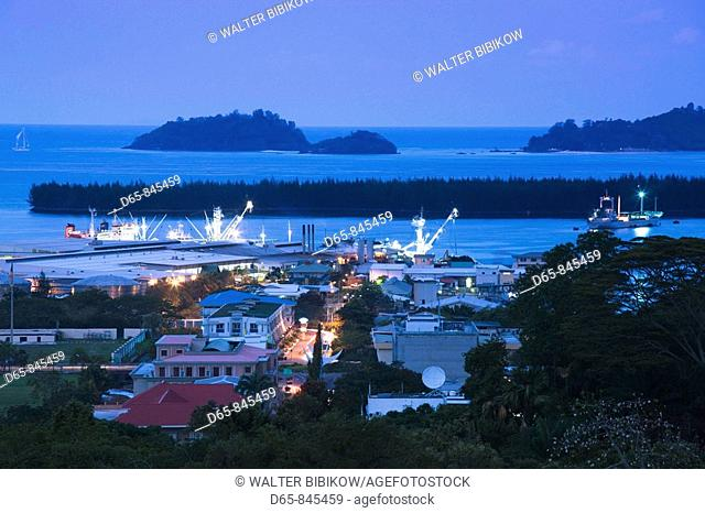 Town & harbor view from Beau Vallon Road at dusk, Victoria, Mahe island, Seychelles