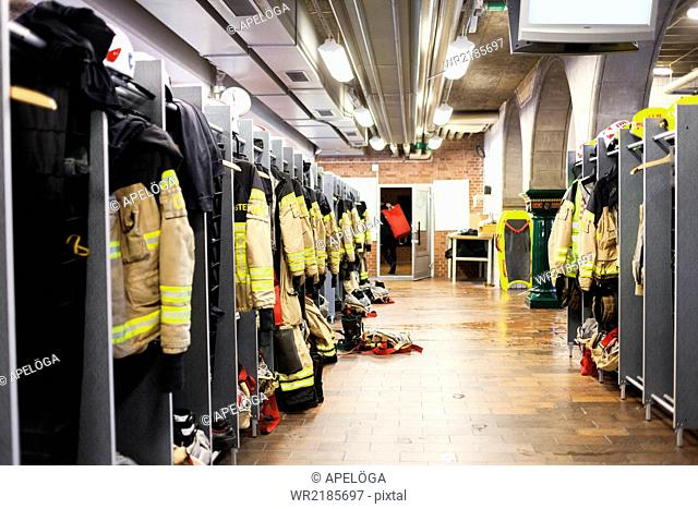 Firefighters uniforms hanging in fire station