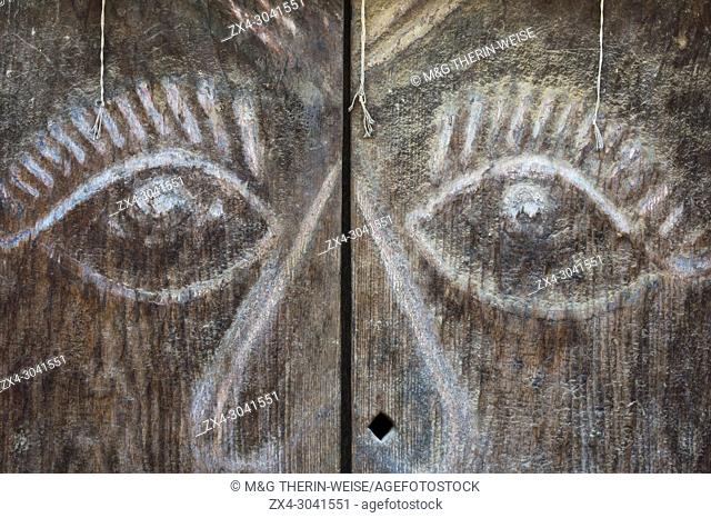 Carved wooden door with a face, Kirtipur, Nepal