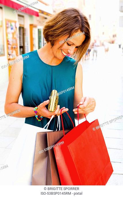 Woman examining shopping bags