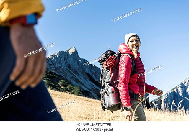 Austria, Tyrol, happy woman with man hiking in the mountains