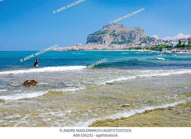 Beach at Cefalu. La Rocca in background. Sicily. Italy