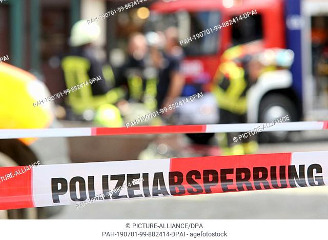01 July 2019, Saxony-Anhalt, Wernigerode: In Wernigerode a historical building is on fire. The 17th century house belongs to the historic town centre