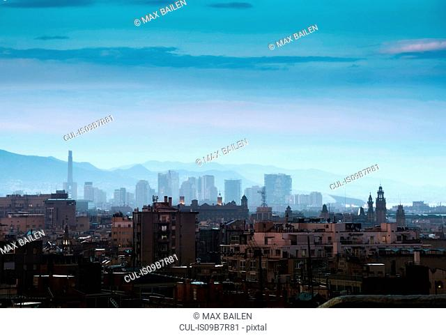 Elevated cityscape and hazy skyline at dusk, Barcelona, Spain