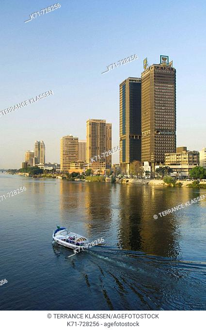 A Nile River taxi and the city skyline of Cairo, Egypt