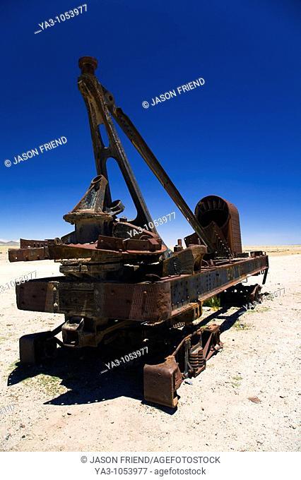 Bolivia, Southern Altiplano, Uyuni  Rusty railway vehicle within a train cementary near Uyuni