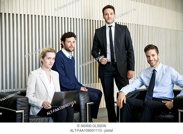 Business team members, portrait