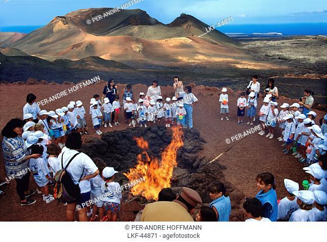 School class gathering around a fire, Timanfaya National Park, Lanzarote, Canary Islands, Spain, Europe