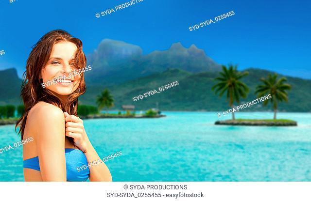 happy woman in bikini swimsuit on bora bora beach