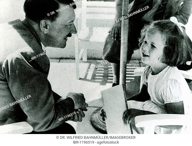 Adolf Hitler talking with a girl, historical photo circa 1937