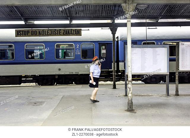 Station attendant checking trains going to Berlin Germany