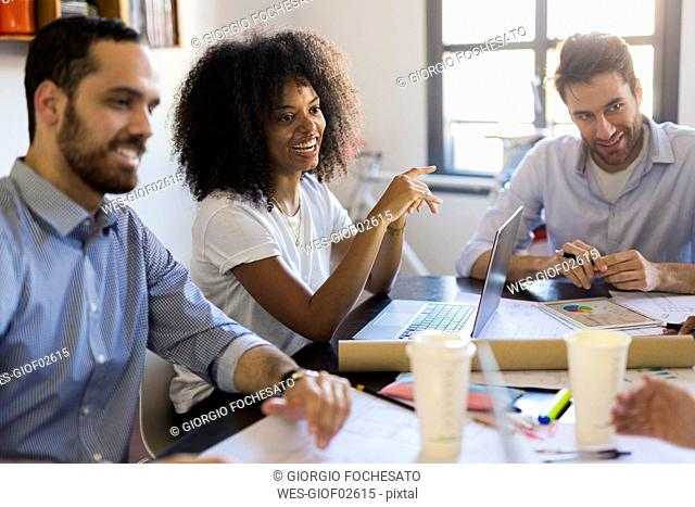 Happy business people having a meeting in office