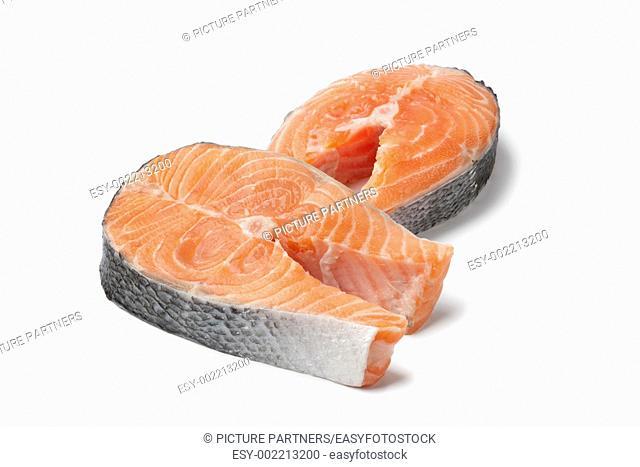 Fresh slices of salmon on white background