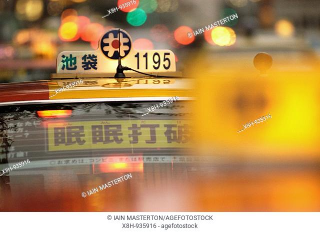 Lamps on taxis at night in central Tokyo