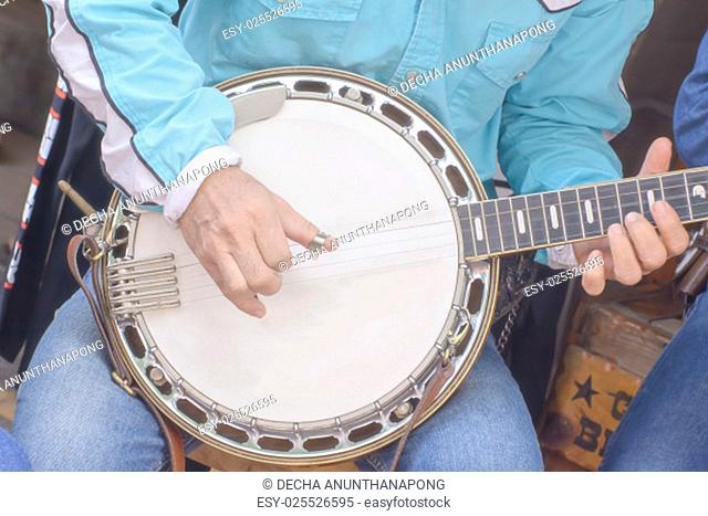 The banjo is a four, five six stringed instrument with a thin membrane stretched over a frame or cavity as a resonator, called the head
