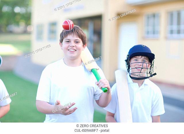 Boy catching cricket ball