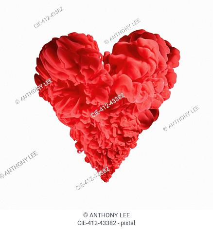 Red ink forming heart-shape on white background