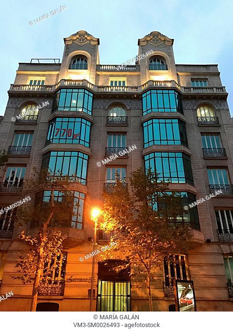 Facade of house, night view. Serrano street, Madrid, Spain