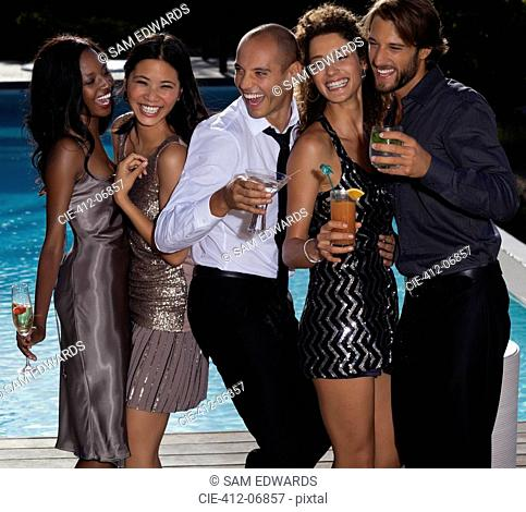 Friends laughing at party