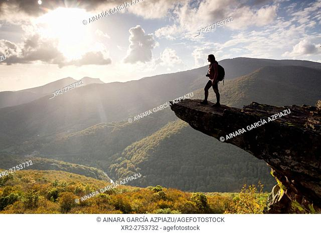 Woman backpacker in Zamariain viewer, Navarre, Spain