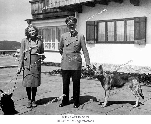 Eva Braun and Adolf Hitler, with their two dogs Wulf and Blondi at the Berghof, 1942