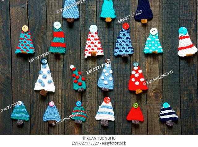 Handmade ornament for winter holiday, group fo knitted pine tree to decor for christmas season, colorful knitting product with button to Xmas decoration