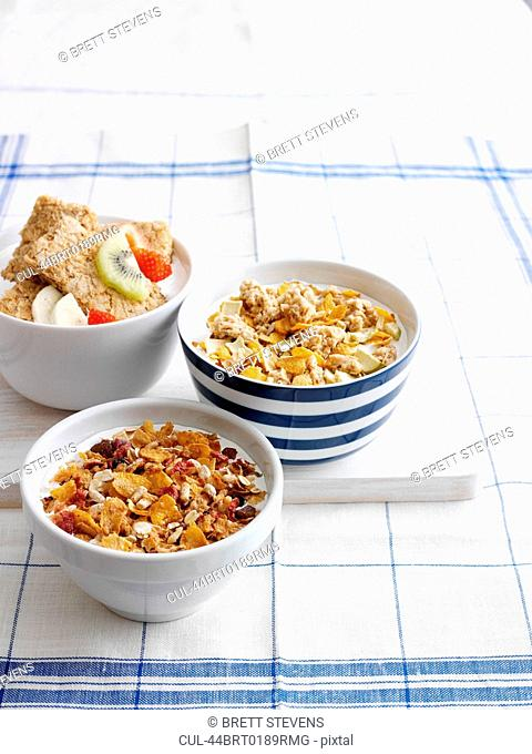 Bowls of breakfast cereal with fruit