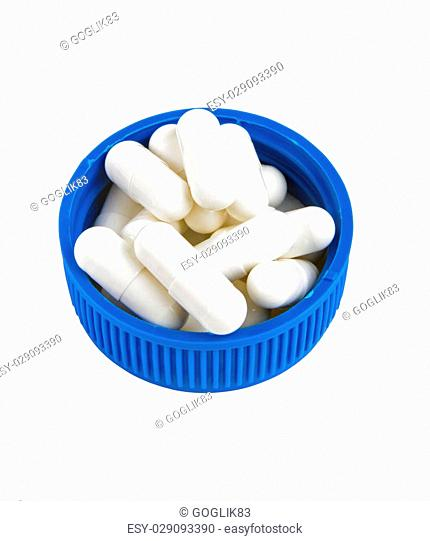 white medicine pills on the blue cover