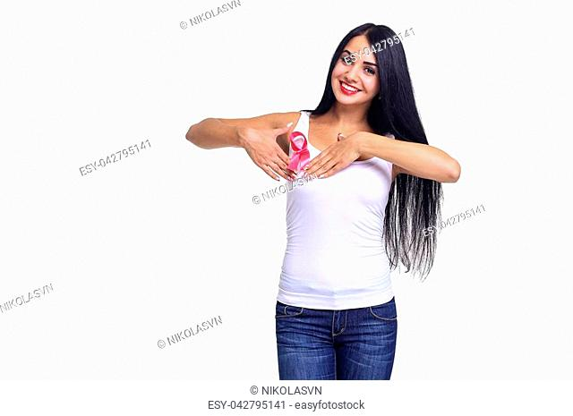 healthcare and medicine concept - smiling beautiful woman in blank t-shirt with pink breast cancer awareness ribbon on the white background