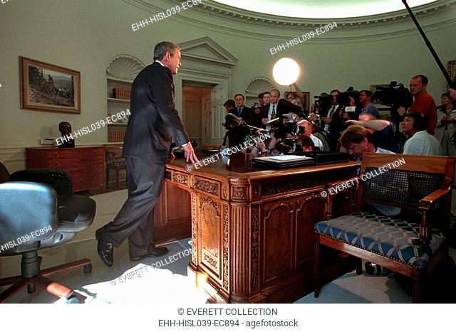 Oval Office press conference on Sept. 13, 2001, 2 days following the 9-11 Terrorist Attacks. President George W. Bush talks with reporters after his telephone...
