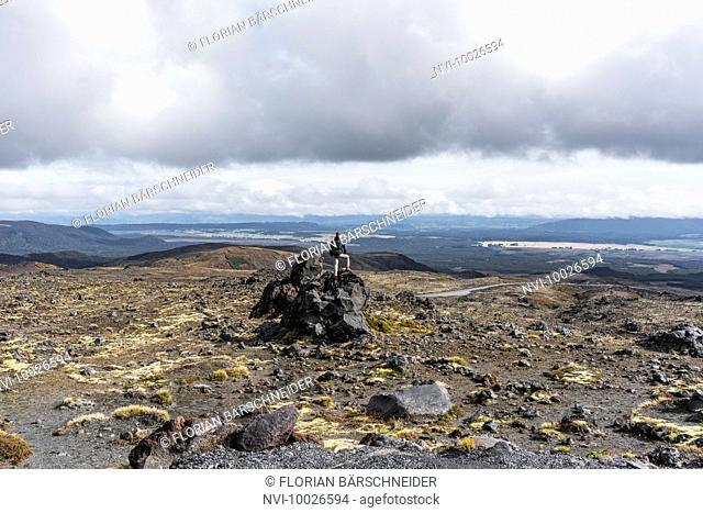 Rocky viewpoint, man at Ruapehu, New Zealand