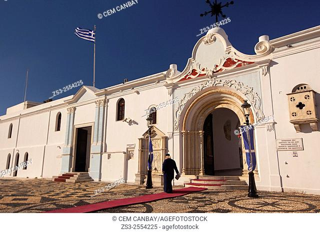 Priest at the entrance of the Panagia Evangelistria-Our Lady of Tinos church, Hora, Tinos, Cyclades Islands, Greek Islands, Greece, Europe