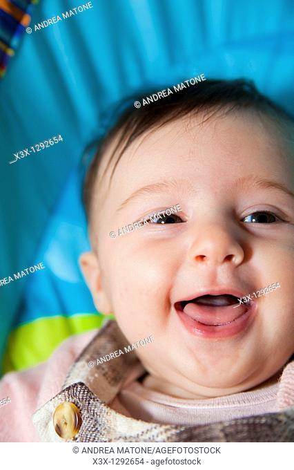 Baby girl having fun