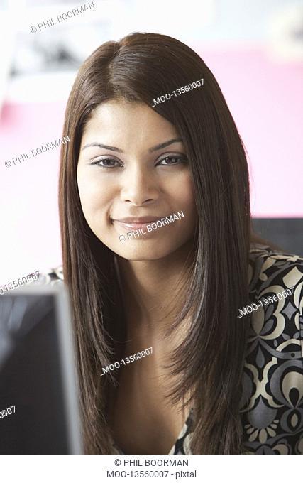 Office worker sitting behind desk portrait