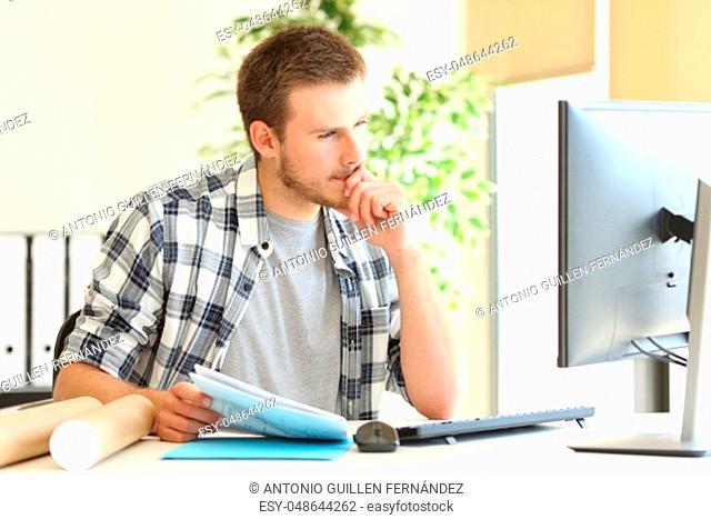 Designer or architect working on line with a computer in a desktop at office