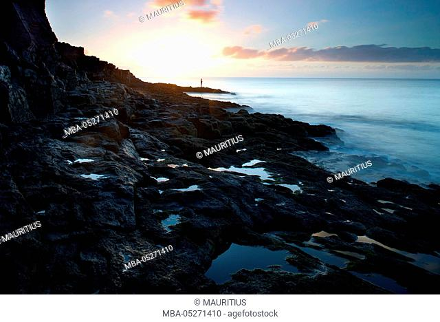 Angler at the coast Lanzarotes in the sunrise
