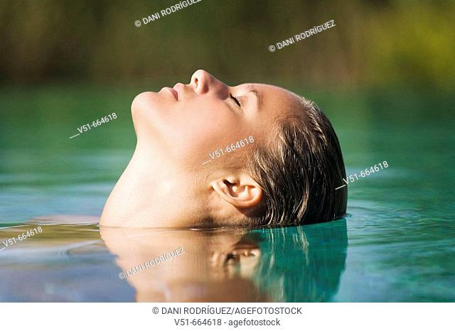 Young woman in swimming-pool