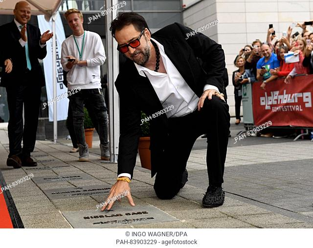 As the star guest to the film festival, US actor Nicolas Cage touches his star on the Walk of Fame by the Oldenburgische Landesbank (OLB) in Oldenburg, Germany