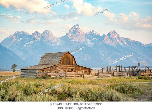 Famous John Moulton Barn stands in front of Teton Mountain Range on a cloudy day, Grand Tetons National Park, Teton County, Wyoming. USA