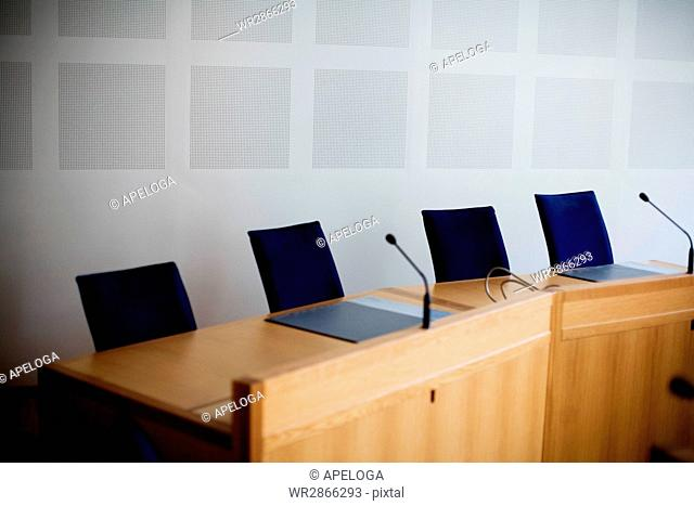 Microphones at empty conference table