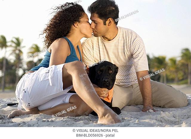 Hispanic couple kissing