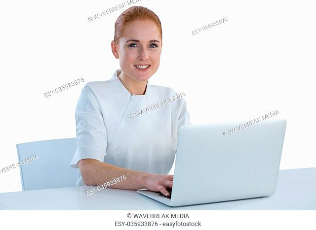 Portrait of young businesswoman using laptop computer