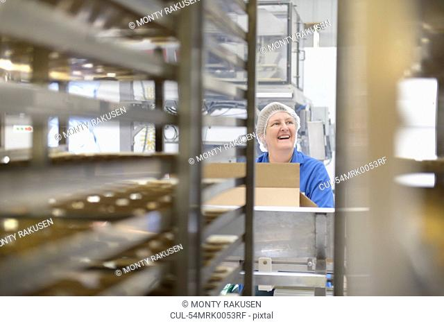 Worker packing in biscuit factory
