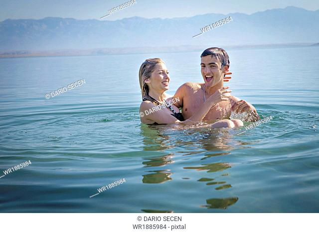Croatia, Young couple swims in the Adriatic Sea