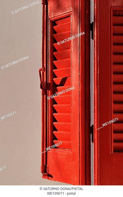 partially open window's shutter