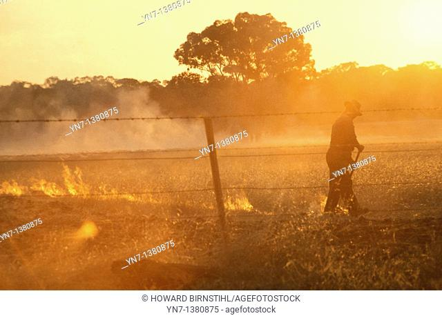Hazy, smoky summer days as the farmer burns off the stubble in his fields while the sun turns the scene a bright orange