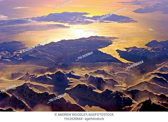Aerial view of winter snow covered mountains extending south to Gulf of Alaska Alaska USA